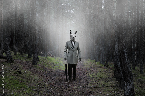 Fotografie, Obraz Mystical picture of a strange creature with guanaco head in a mysterious forest