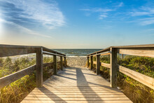 Footbridge At Beach Against Sky In Sunny Day