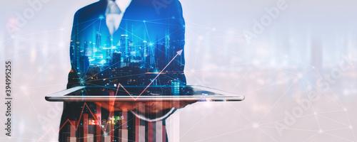 Obraz na plátně Business man using tablet on futuristic network and digital marketing city techn