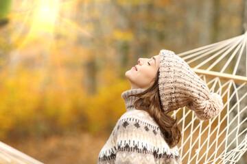 Fototapeta Berlin Woman breathing fresh air in autumn in a forest