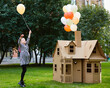 canvas print picture - Child playing in a cardboard playhouse. Eco concept