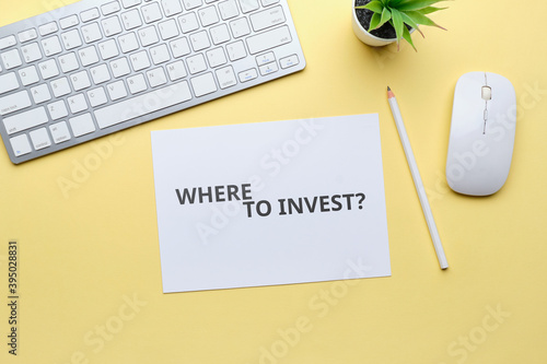 Photo Handwritten question where to invest concept on paper