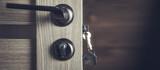 key in room wooden door