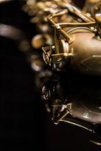 Vintage Saxophone On A Black Background