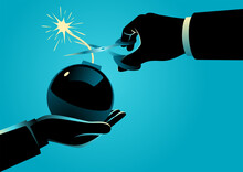 Man Giving A Bomb With A Lit Fuse And Other Man Trying To Diffuse It By Cutting The Fuse