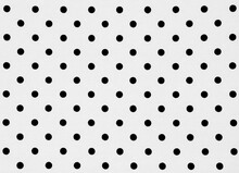 Close Up Of Polka Dots Over White Background