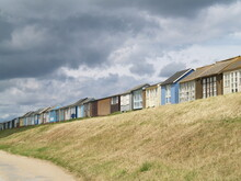 Scenic Beach Huts On A Cloudy Day