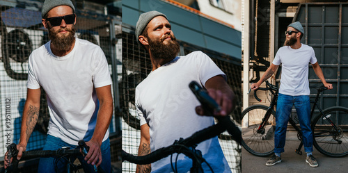 Obraz Young bearded hipster guy wearing white blank t-shirt ride on bicycle . Mock-up for print. T-shirt template. - fototapety do salonu