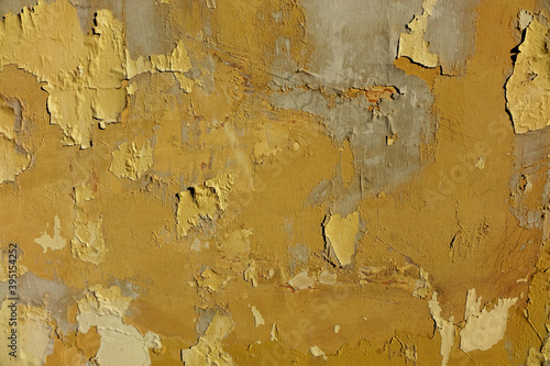 Fotomural Wall with peeled bright paint, yellow orange gray plaster