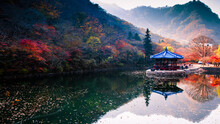 Scenic View Of Lake By Buildings During Autumn