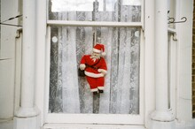 Santa Claus Doll Hanging On Window At Home