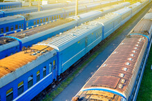 Top View Of Standard Blue Railway Carriages At Station Platforms At Daytime.