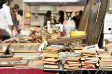 Stack Of Books At Market Stall For Sale
