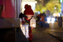 Sweet Little Toddler Boy, Holding Lantern And A Teddy Bear At Night In Prague