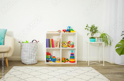 Fotografija Organized space with children's toys and books