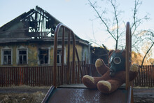 Teddy Bear In A Gas Mask Near The Burned Down House 2