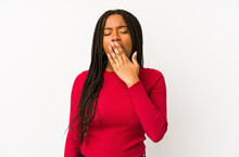 Young African American Woman Isolated Yawning Showing A Tired Gesture Covering Mouth With Hand.
