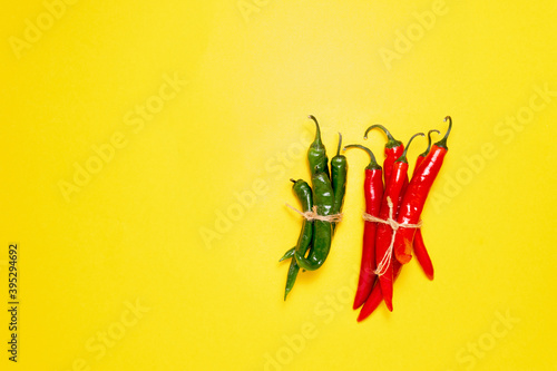 Valokuva Red and green chili peppers, shot from above with a place for text