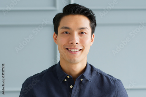 Fototapeta Portrait young confident smart Asian businessman look at camera and smile obraz