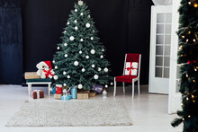 New Year's Christmas Tree With Gifts And Decor Garlands Interior