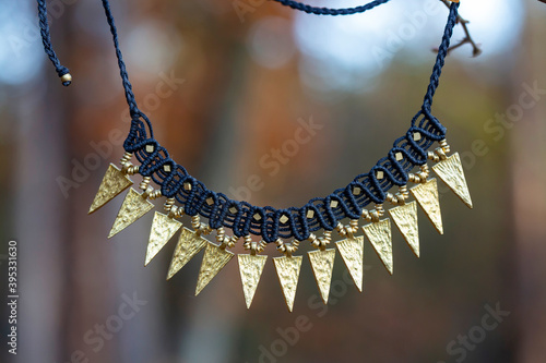 Boho style necklace with metal components in the forest background Canvas