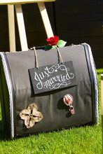 Suitcase With Beautiful Red Rose With Inscription Just Married Outdoors