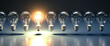 Leinwandbild Motiv A row of lightbulbs with one brigthly lit - concept for having an idea, innovation, standing out. Web banner size
