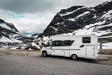 Camper Van In The Snowy Mountains