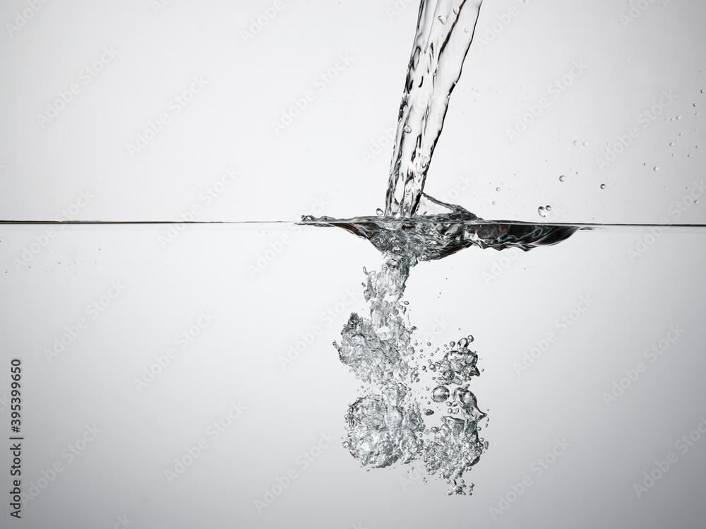 Fototapeta Jet splashing into water surface view