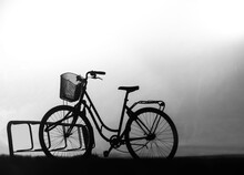 Back Lit Silhouette Of Bike In Bicycle Stand