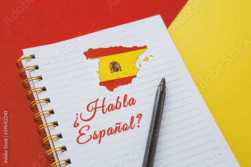 Fotografie, Obraz notebook with the spanish flag and the inscription Do you speak spanish in Spani