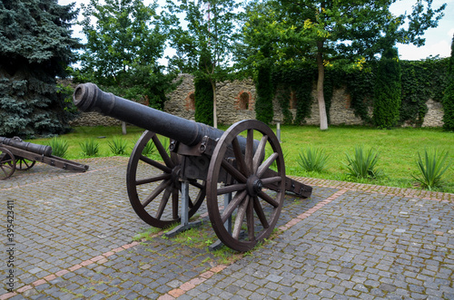 Canvas Old historic cannon on wooden wheels, stands in the courtyard of Dubno castle, Rivne region, Ukraine