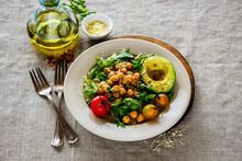 Healthy Chickpeas Salad With Avocado, Arugula, Cherry Tomato And Parmesan