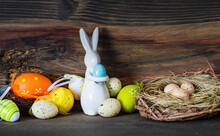 Easter Card Concept With Easter Eggs And Bunny On Wooden Rustic Background