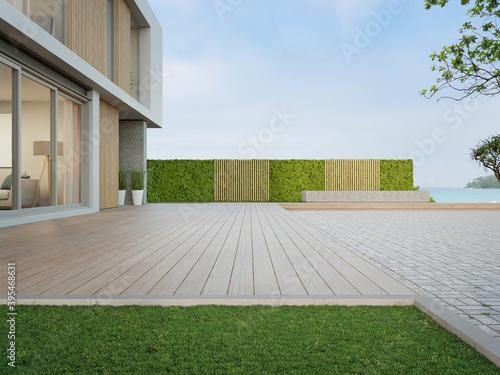 Photo Beach house with wooden terrace near empty cobblestone floor for car park