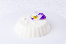 Panna Cotta Decorated With Edible Violet Flower