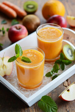Two Glasses Of Fruit Juice On A Tray