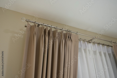 Fototapeta Beautiful curtains with ring-top rail, Curtain interior decoration in living room obraz