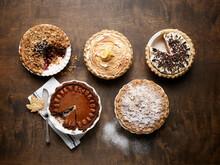 Candied Pecan Pumpkin Pie, Cinnamon-Oatmeal Crumble Blueberry Pie, Citrus-Cranberry Crumble Apple Pie, Gingerbread Chocolate Cream Pie, Limoncello Meringue Pie