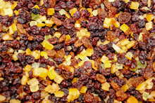 Close Up Of Dried  Red And Yellow Raisins, Currants, Sultanas, Mixed Orange , Lemon And Lime Peel, And Zest, Cranberries, And Suet . Ingredients For Mince Meat For Pies And Christmas Cake.