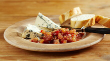 Sweet Pear Chutney With Chili Served With Blue Cheese And Sliced Baguette On A Wooden Dish