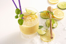 Mango Rice Shake With Lime And Honey In A Glass With A Drinking Straw