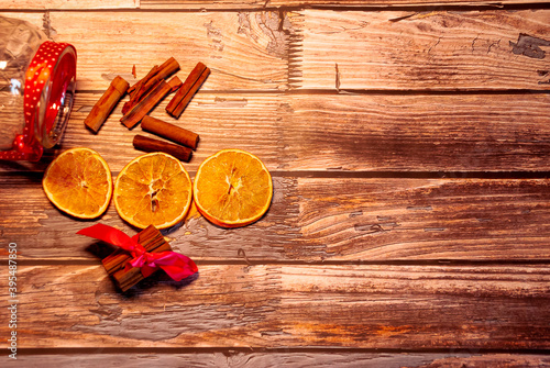 Fototapeta Dried oranges with cinnamon on a wooden table obraz
