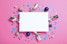 Flat Lay Composition Of Christmas Crackers, Decorations, Shiny Confetti And Blank Paper On Pink Background. Space For Text