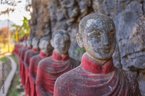 Tela Statues of Buddhist monks at the Win Sein Taw Ya Buddha in Kyauktalon Taung, near Mawlamyine, Myanmar
