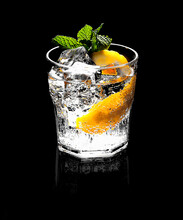 Old Fashioned Glass With Ice And Fizzy Clear Beverage
