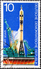 GERMANY, DDR - CIRCA 1975 : A Postage Stamp From Germany, GDR Showing A Soyuz Space Capsule At Launch. Soviet-American Space Company Soyuz-Apollo.
