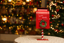 Red Mailbox For Letters To Santa Claus On The Background Of A Glowing Christmas Tree