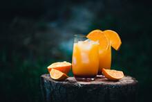 Two Glasses Of Vodka Sunrise Made With Orange Juice And Grenadine
