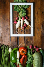 Flat Lay Of Bunch Of Red And White Radish In White Frame And Set Of Various Fresh Vegetables